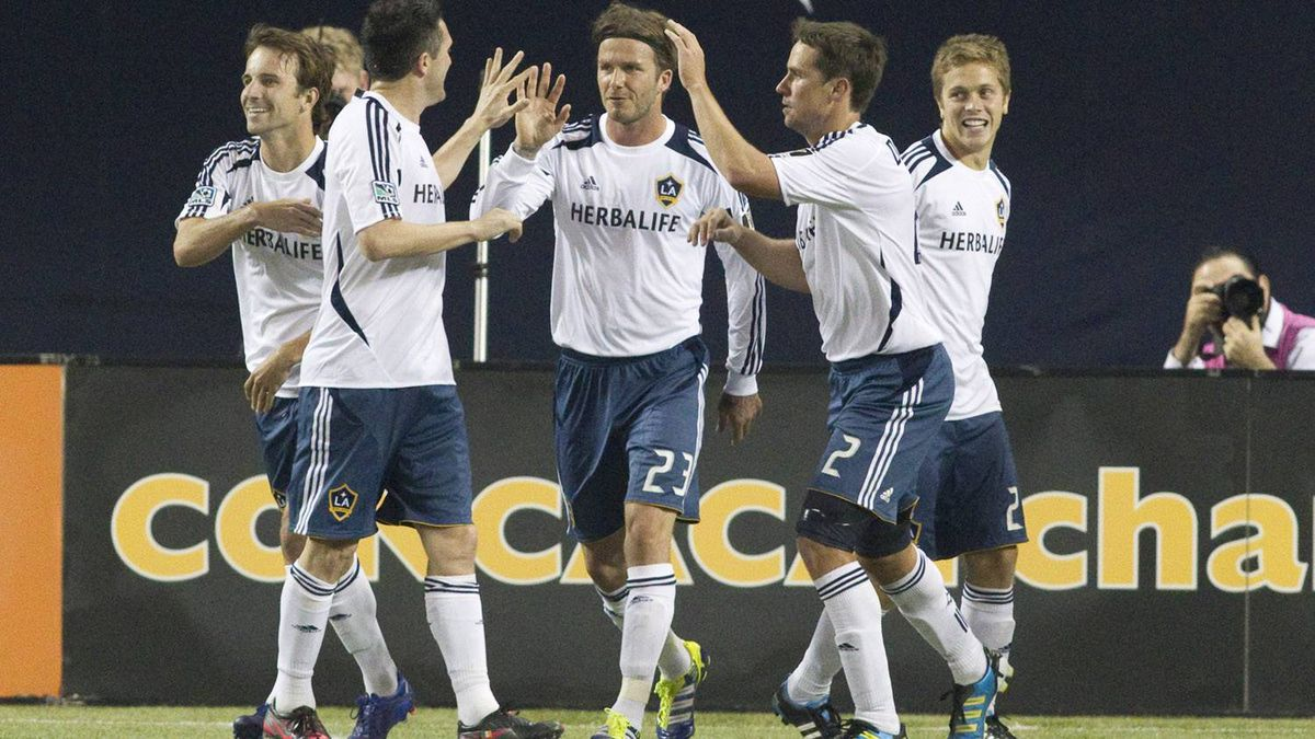 David Beckham and his L.A. Galaxy teammates celebrate their late game-tying goal.