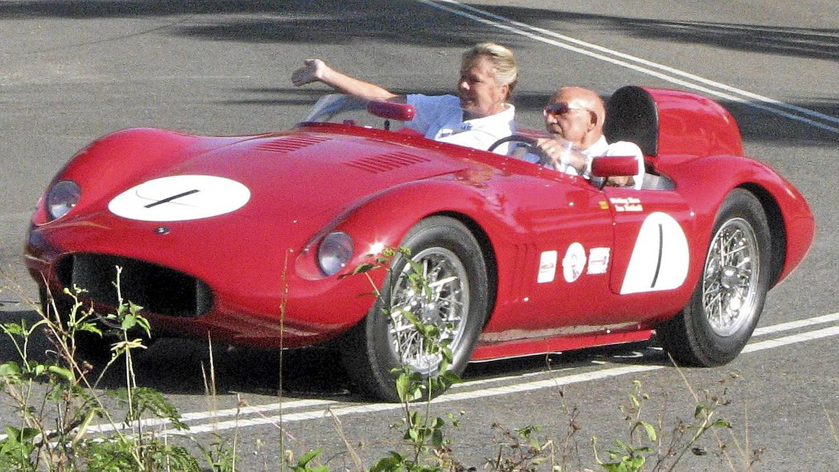 Sir Stirling and Lady Moss -- in his OSCA during the hillclimb. She's pointing the way around the corner.__Credit: Bob English for The Globe and Mail