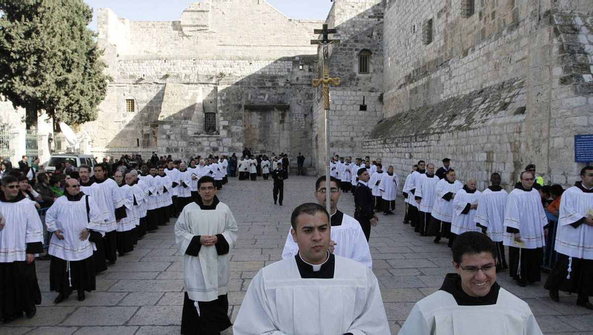 Clergy gather in Manger Square outside the Church of the Nativity while Christians gather for Christmas celebrations in the West Bank city of Bethlehem, on December 24, 2011, as thousands of Christian pilgrims descended on on the holy city to celebrate in Jesus' traditional birthplace.