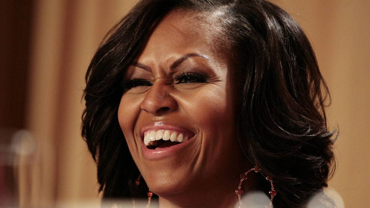 U.S. first lady Michelle Obama laughs at comedian Jimmy Kimmel at the White House Correspondents Association annual dinner in Washington April 28, 2012.