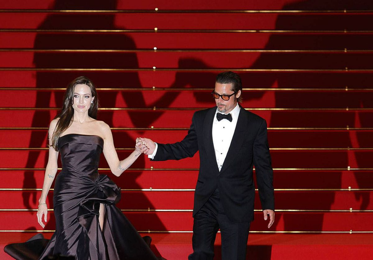 Cast member Brad Pitt and actress Angelina Jolie leave the festival palace after the screening of the film The Tree of Life, n competition at the 64th Cannes Film Festival.