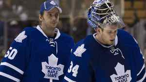 Toronto Maple Leafs goalies Jonas Gustavsson, left, and James Reimer, right, leave the ice after being defeated by the Washington Capitals 4-2 in NHL hockey action in Toronto on Saturday, Feb. 25, 2012. THE CANADIAN PRESS/Nathan Denette