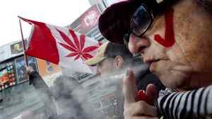 """Pot smokers gather in downtown Toronto for the annual """"4:20"""" rally on April 20, 2011."""