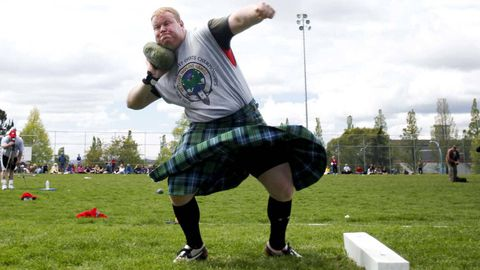 A competitor tosses a largish rock during the 147th Victoria Highland Games and Celtic Festival in Victoria, B.C., in May 2010.