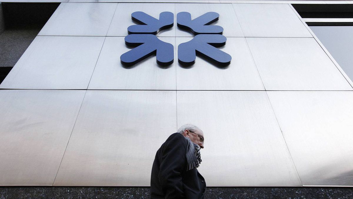 """A pedestrian walks past an RBS branch in the City of London January 27, 2012. Politicians from across the spectrum united in condemning the near one million pound bonus awarded to RBS chief Stephen Hester, with Deputy prime Minister Nick Clegg saying the public sees such sums as """"from another planet."""""""
