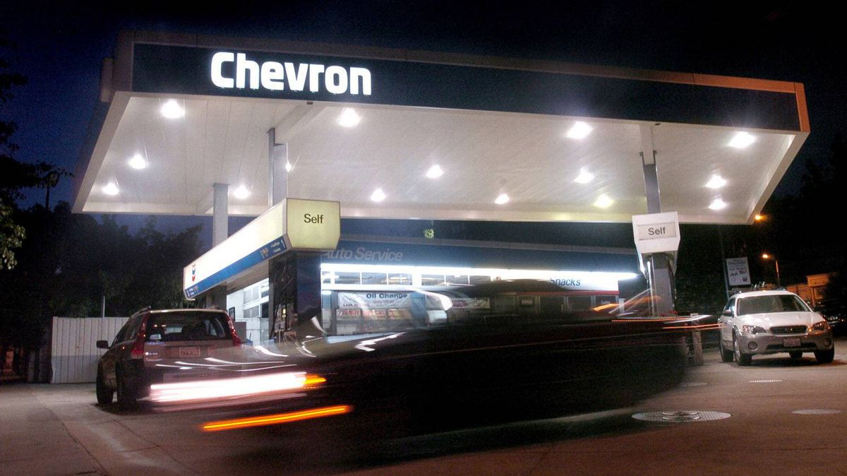 Chevron issues profit warning for fourth quarter.
