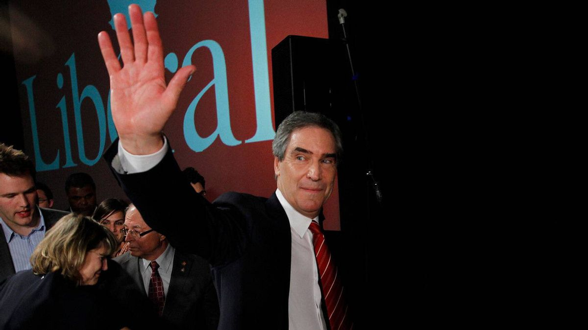 Liberal Leader Michael Ignatieff says goodbye to supporters, with his wife at his side, on May 2, 2011.