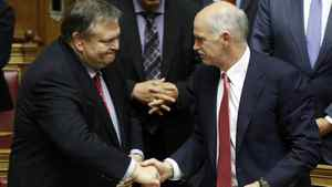 Greek Finance Minister Evangelos Venizelos, left, shakes hands with Prime Minister George Papandreou.