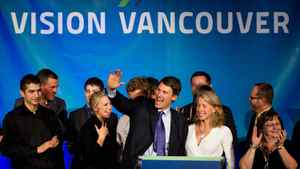 Vancouver Mayor Gregor Robertson, centre, is joined by his wife Amy, centre right, as they celebrate after he was re-elected in a civic election in Vancouver, B.C., on Nov. 19. The man on far left in black is Jinagh Farrouch Navas-Rivas.