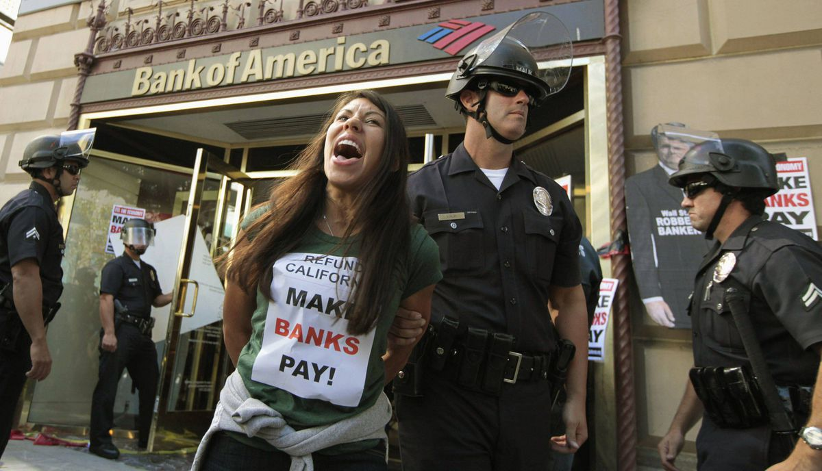 "A woman is arrested after occupying a Bank of America branch during a ""Make Wall Street Banks Pay"" protest march in Los Angeles, California October 6, 2011."