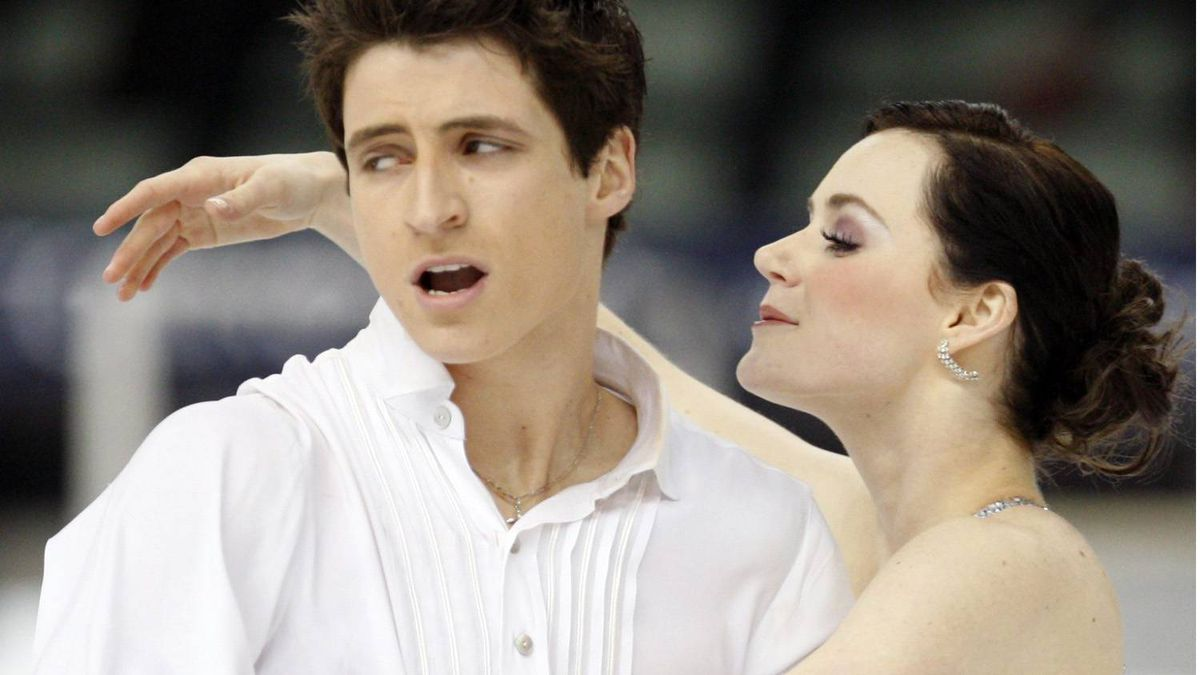 Tessa Virtue and Scott Moir of Canada perform the ice dance program, at the World Figure Skating Championships in Turin, Italy, Friday, March 26, 2010.