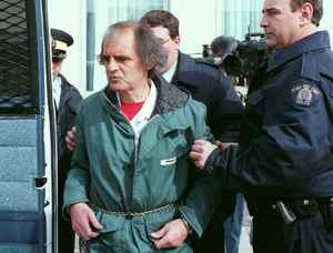 Clifford Olson is led away from court in Regina, Sask., April 4, 1996.
