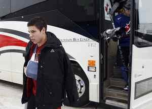 Canada's injured player Travis Hamonic arrives for the team's practice session at the 2010 IIHF U20 World Junior Hockey Championship in Saskatoon.