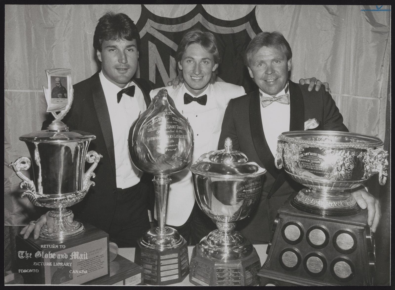 EDMONTON OILERS HOCKEY TEAM Edmonton Oilers Paul Coffey, Wayne Gretzky and coach Glen Sather won four of the eight individual / awards presented night. NHL