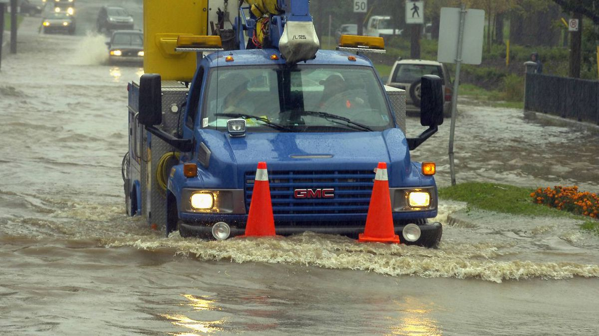 A Newfoundland Power truck drives through a flooded area of Waterford Bridge Road as it responds to calls during Hurricane Igor in St. John's, N.L., on Tuesday, Sept. 21, 2010.