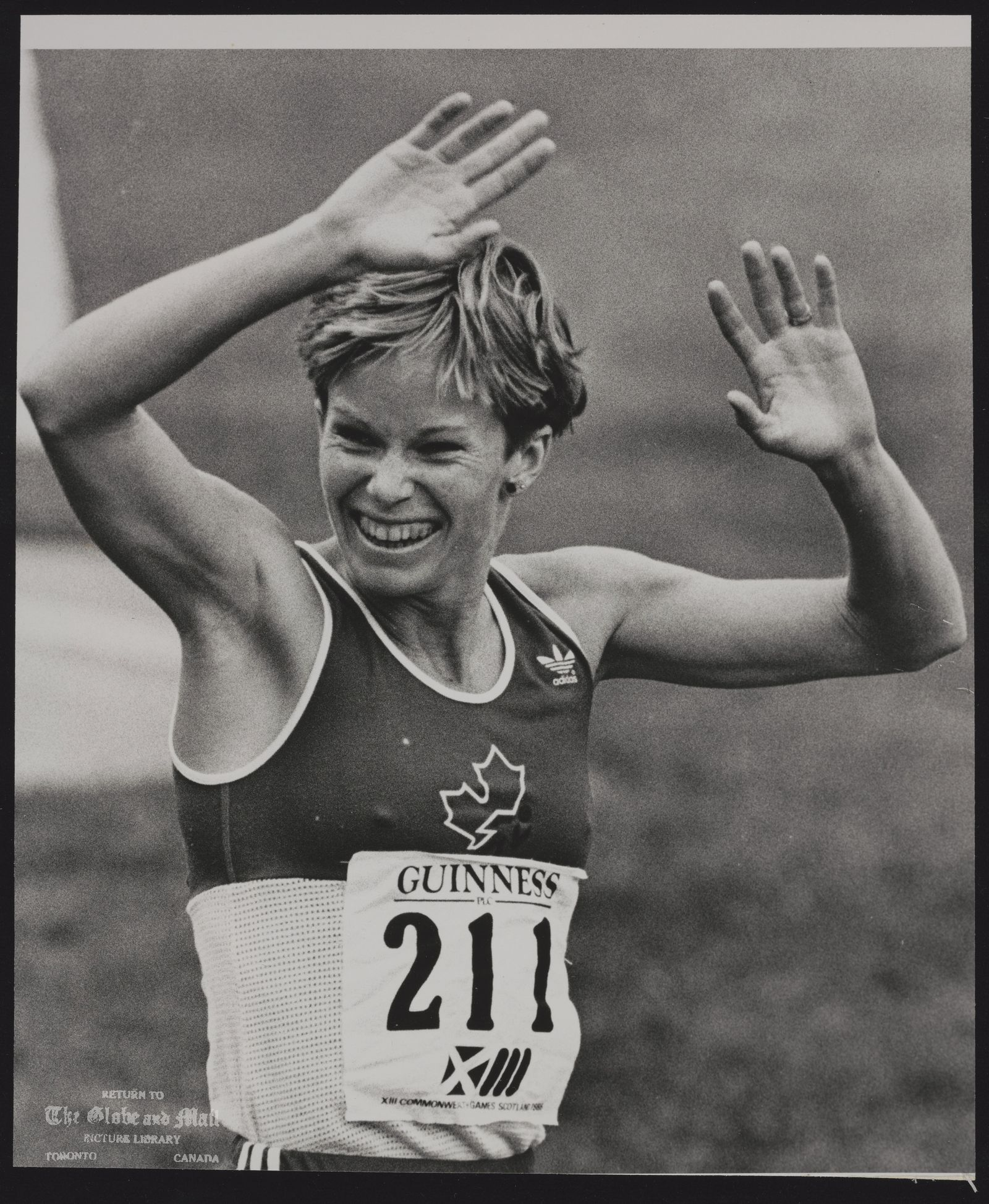 COMMONWEALTH GAMES EDINBURGH (1986) EDI19:SPECIAL FOR THE GLOBE AND MAIL, CANADA EDINBURGH, SCOTLAND, JULY 27-Lynn Williams of Vancouver raises her arms in jubilation after winning the Women's 3000m for another Canadian Gold medal. hd/Hans Deryk