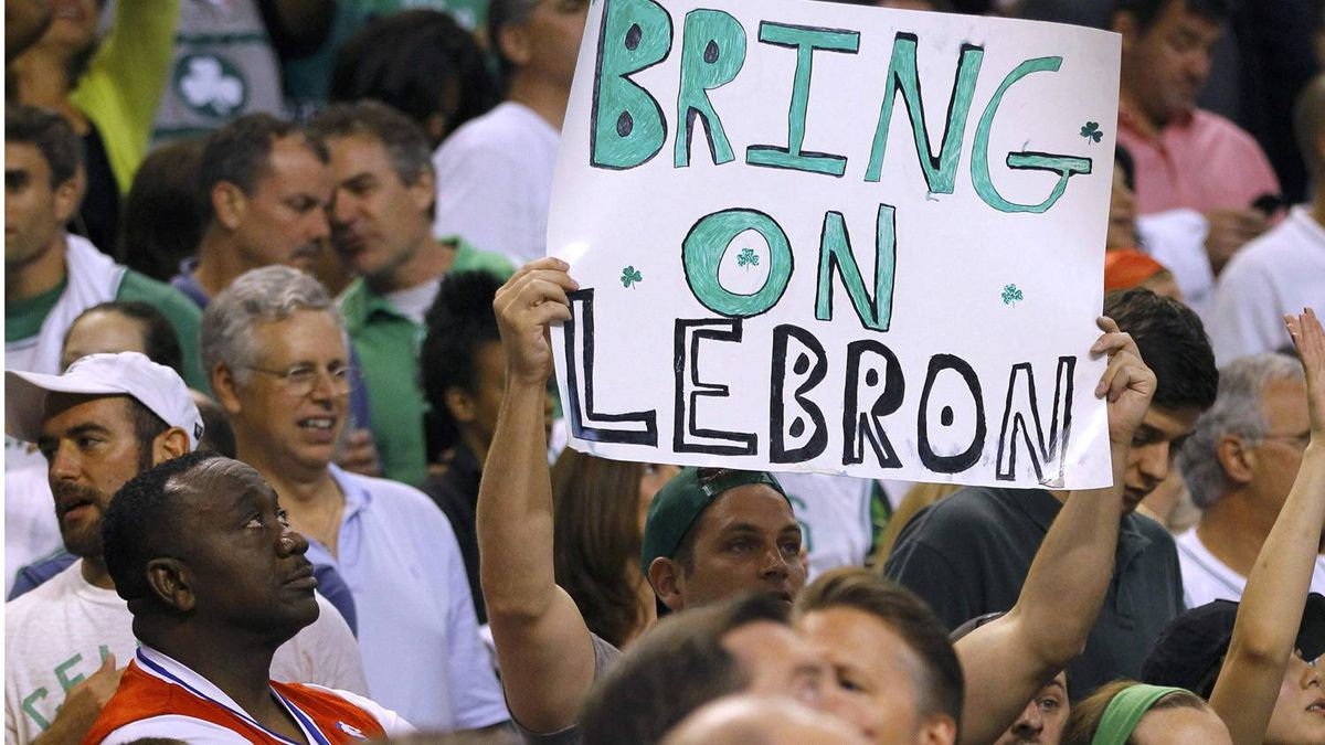 A Boston Celtics fan holds up a sign as he cheers during the fourth quarter. REUTERS/Brian Snyder