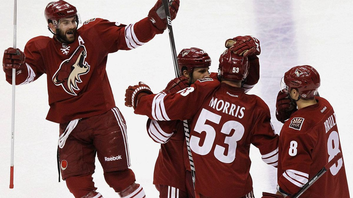 Phoenix Coyotes' Derek Morris (53) celebrates his goal against the Los Angeles Kings with teammates Keith Yandle, left, Gilbert Brule (8), and Daymond Langkow during the first period of Game 1 of the NHL hockey Stanley Cup Western Conference finals, Sunday, May 13, 2012, in Glendale, Ariz.(AP Photo/Ross D. Franklin)