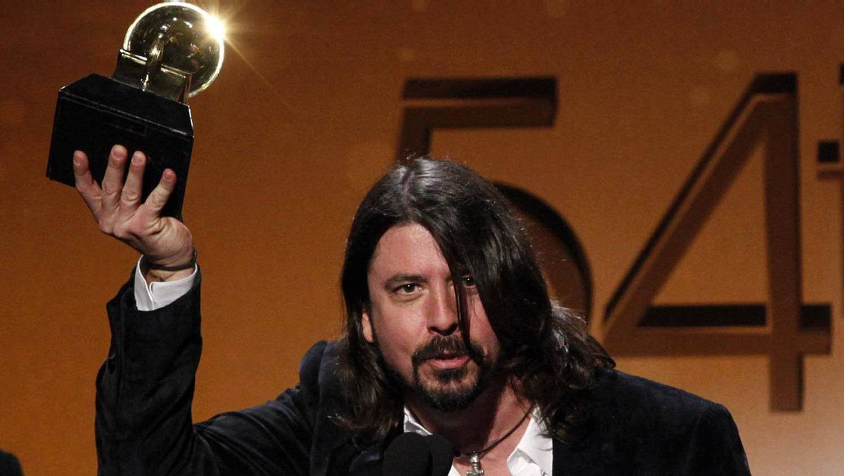 Dave Grohl of Foo Fighters celebrates after winning Best Rock Album for Wasting Light.