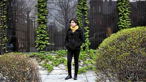 Hadia Akhtar stands outside of Robarts library on the University of Toronto campus. Akhtar is a recent political science and economics graduate and, like many of her contemporaries, plans to pursue post-graduate work because there are no jobs for her.
