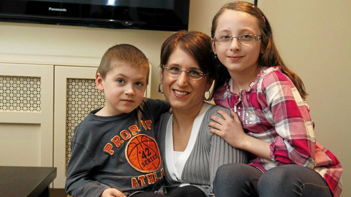 Marketing Consultant Teresa Randall photographed with her two kids, 8-year-old Martina and 5-year-old Evan at their home in Vaughan, Ontario March 27, 2012. Photo by: