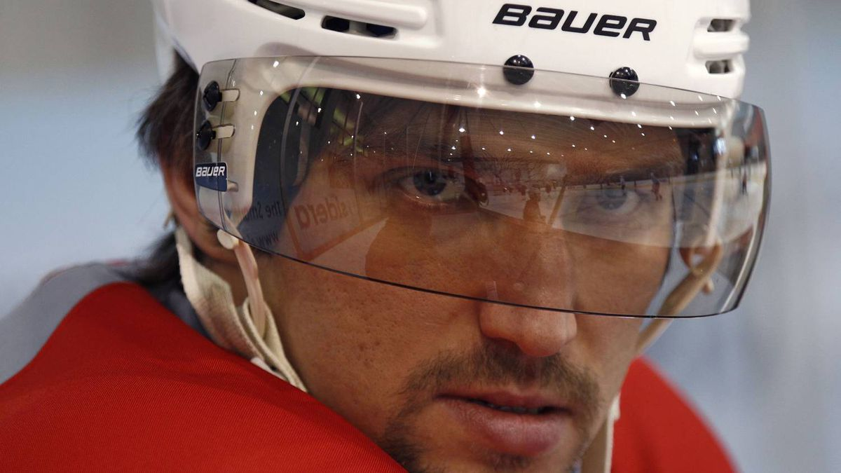 Alex Ovechkin, captain of the Washington Capitals, watches his team practice in Arlington, Virginia, April 27, 2012. The Capitals defeated the Stanley Cup champions Boston Bruins on Wednesday and will face the New York Rangers in the next round of the NHL playoffs. REUTERS/Kevin Lamarque