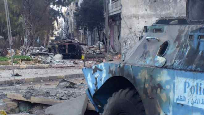 Two damaged armoured military vehicles are seen after clashes between President Bashar al-Assad forces and Free Syrian Army (FSA) in Cairo square near Khaldiyeh area in Homs Feb. 4, 2012.