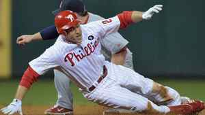 Chase Utley #26 of the Philadelphia Phillies is caught attempting to steal second base in the bottom of the sixth inning against Nick Punto #8 of the St. Louis Cardinals during Game Five of the National League Divisional Series at Citizens Bank Park on October 7, 2011 in Philadelphia, Pennsylvania. (Photo by Drew Hallowell/Getty Images)
