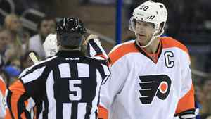 Philadelphia Flyers defenseman Chris Pronger (20) argues with referee Chris Rooney (5) after he called for a face-off as the Flyers were using their stall tactic during the first period of an NHL hockey game against the Tampa Bay Lightning, Wednesday, Nov. 9, 2011, in Tampa, Fla.