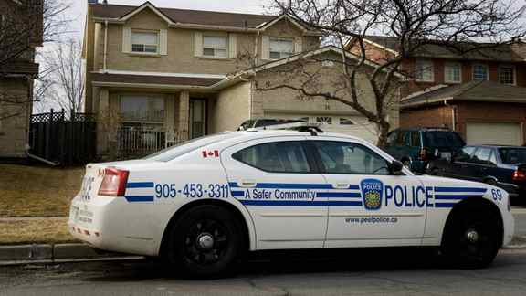 A Peel Police vehicle sits in front of a home in Bolton, Ont.