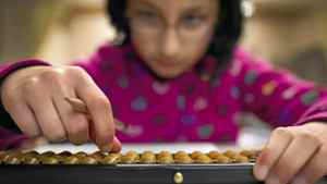 Student Vedanshi Vala, 10, takes part in an advanced after-school abacus class in Richmond, B.C. on Jan. 11, 2012.