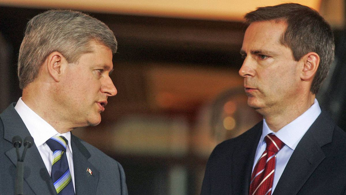 Prime Minister Stephen Harper speaks to Ontario Premier Dalton McGuinty at a transit-funding announcement in Toronto on May 15, 2009.