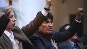 Bolivia's President Evo Morales, right, sings the national anthem in La Paz, May 1, 2012. Mr. Morales announced on May Day that Bolivia is nationalizing the local unit of Spain's Red Electrica.