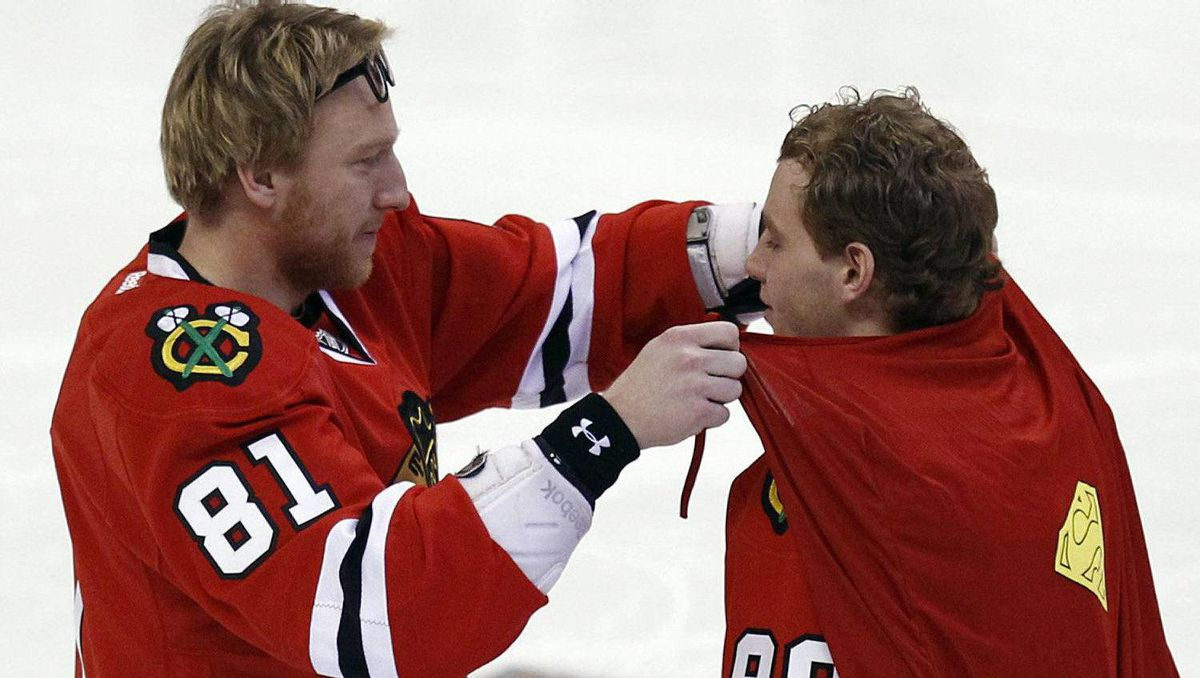 Chicago Blackhawks Marian Hossa (L) ties a Superman cape on teammate Patrick Kane during the NHL All-Star hockey skills competition in Ottawa January 28, 2012. REUTERS/Blair Gable
