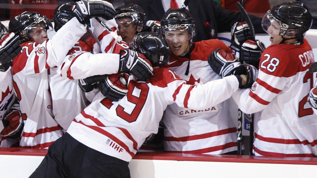 Team Canada's John Tavares is mobbed by teammates after scoring the game winning goal on Team Russia goalie Danila Alistratov during a shoot-outin the semi-final action at the world junior hockey championship in Ottawa, Saturday, Jan. 3, 2009.