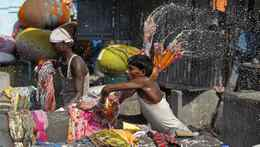 Laundrymen work at the Dhobi Ghat open air laundry in Mumbai November 8, 2010.