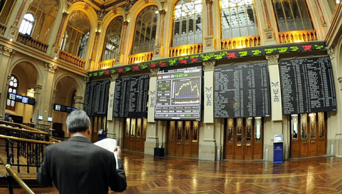 A man reads documents at Madrid's stock exchange this week.