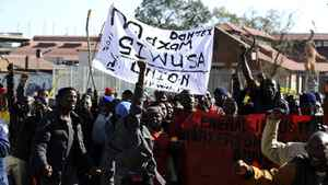 Members of the Chemical, Energy, Paper, Printing, Wood and Allied Workers Union of South Africa (CEPPWAWU) and the General Industries Workers Union of South Africa (GIWUSA) protest through the streets of Johannesburg on July 12, 2011 demanding a minimum salary of 6,000 rand ($890, 630 euros) a month and a 40-hour work week and six months' paid maternity leave.