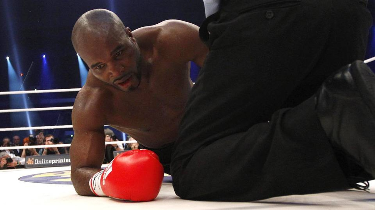 Jean-Marc Mormeck of France is counted out after receiving a knock out punch from heavyweight boxing title holder Vladimir Klitschko of Ukraine during their IBF/WBO, WBA and IBO world heavyweight championship title fight in Duesseldorf March 3, 2012.
