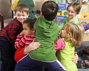Liberal Leader Michael Ignatieff is smothered as he gets a group hug from children after reading to them at an Ottawa daycare on Tuesday, October 20, 2009.
