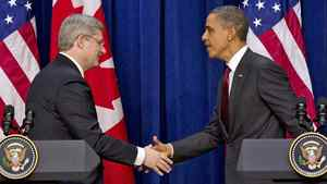 Prime Minister Stephen Harper shakes hands with U.S. President Barack Obama after a joint news conference in Washington on Feb. 4, 2011.
