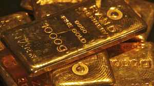 Gold bars are displayed at a gold jewellery shop in the northern Indian city of Chandigarh May 8, 2012. Despite the fresh mess in the euro zone, gold dropped to a four-month low, below $1,600 (U.S.) an ounce. Scared investors are moving into dollars, Treasuries and bonds. But not gold.