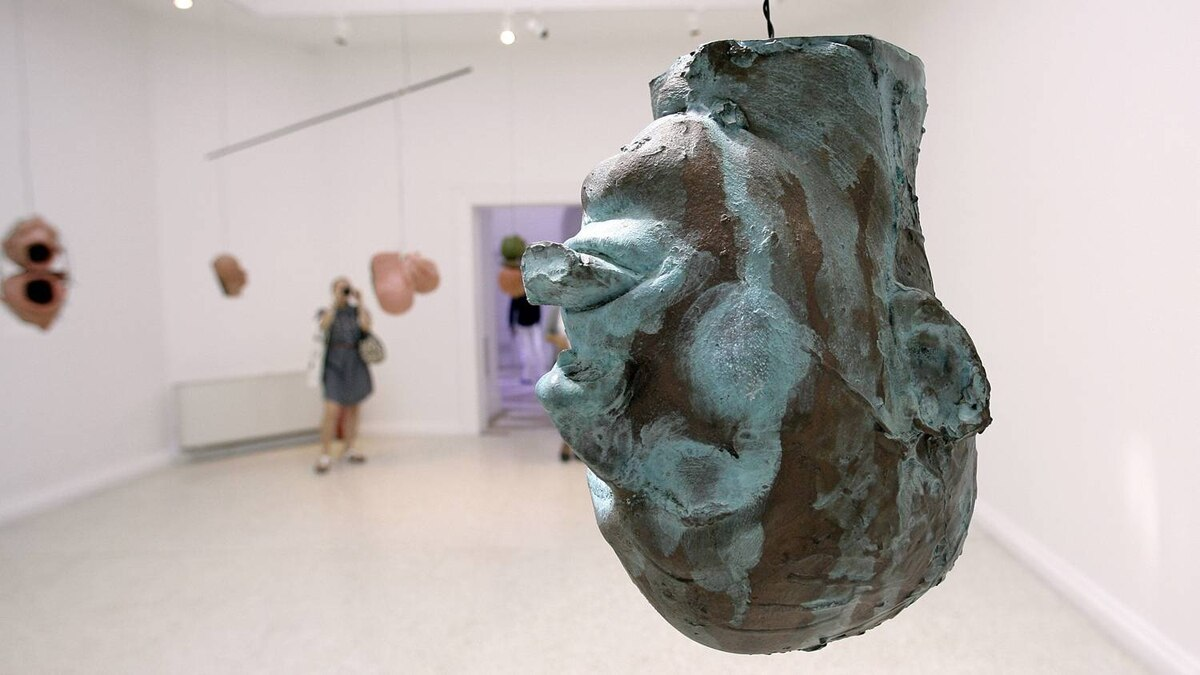 """A sculpture by American artist Bruce Nauman called """"Hanging head for Leo"""" is seen at the United States pavilion during the vernissage of the 53rd Biennale International Art Exhibition in Venice, Italy."""