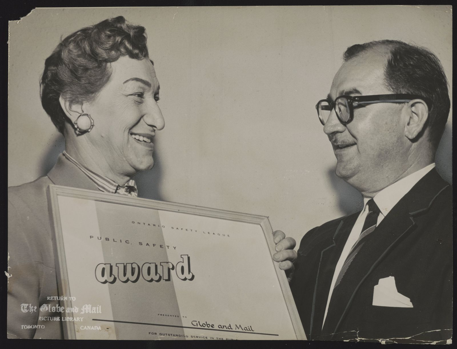TORONTO GLOBE AND MAIL HISTORICAL-MISCELLANEOUS Miss Bobbie Rosenfeld receives safety Award from Transport Minister Yaremko
