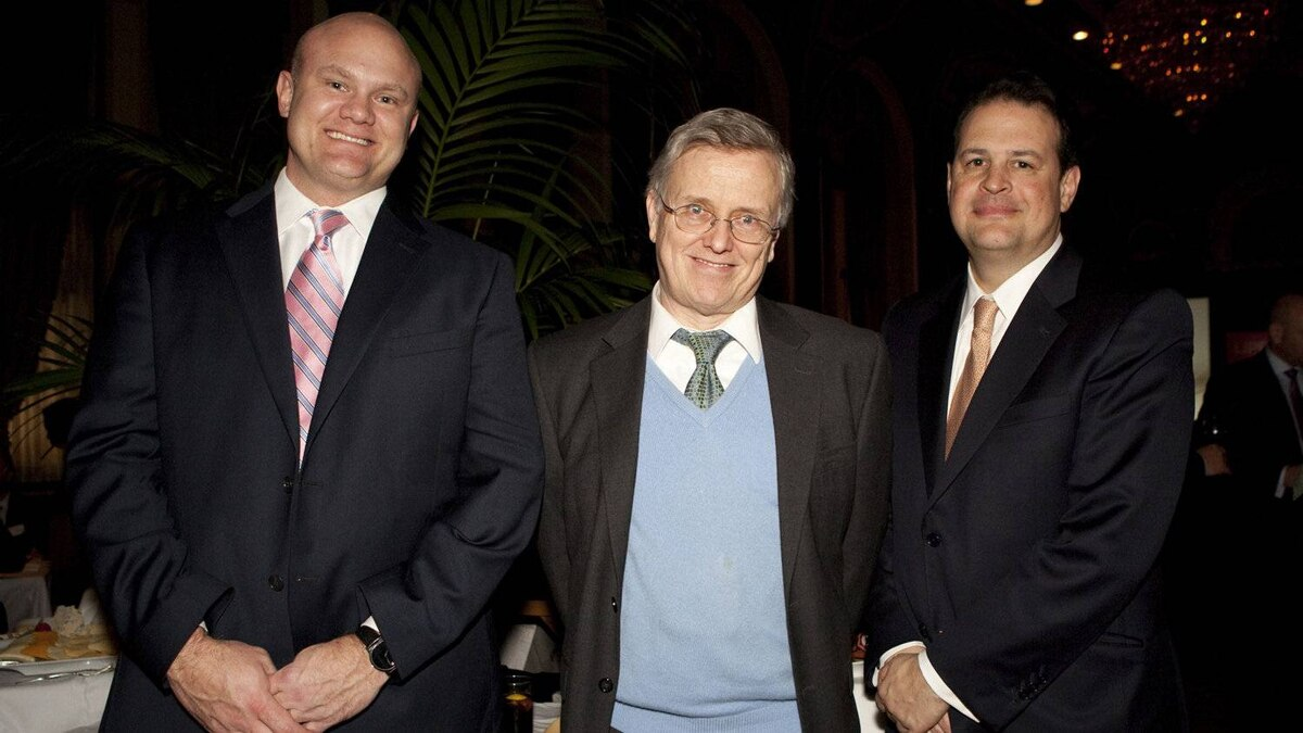 Darren Duffy of Thomson Reuters, left, keynote speaker Philip Tetlock, middle, and Jim Weber of Thomson Reuters pose for a photo during the awards ceremony.