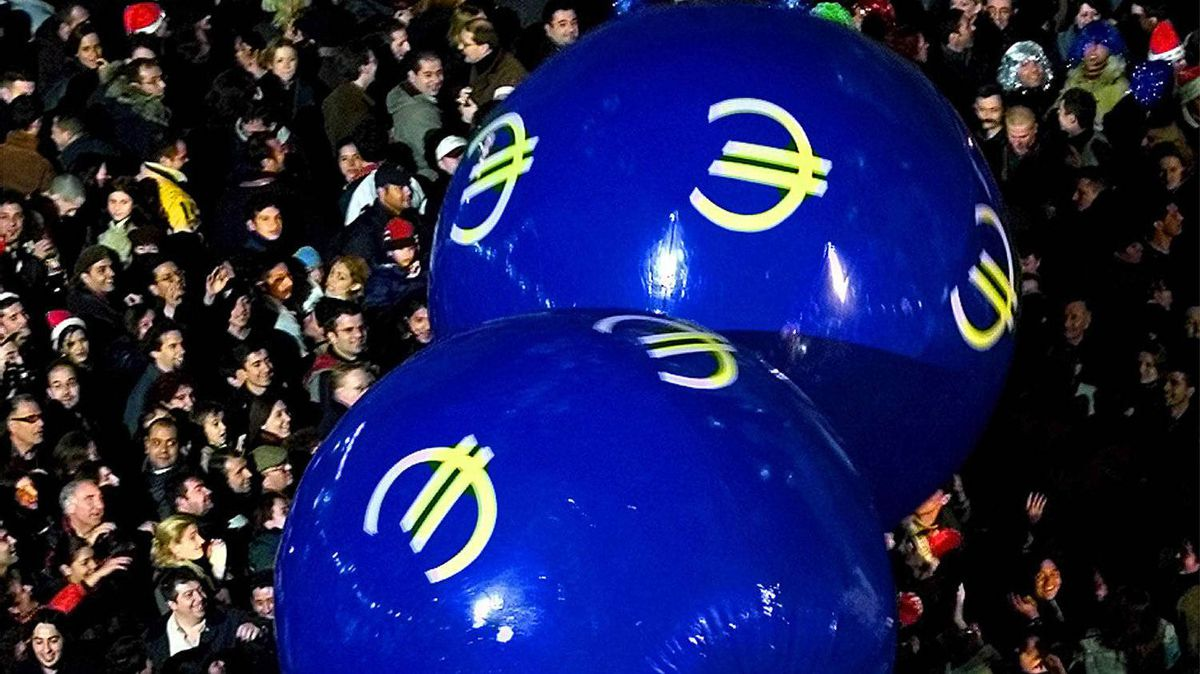 People play with balls bearing the euro symbol at Madrid's Puerta del Sol, shortly before the introduction of euro notes and coins.