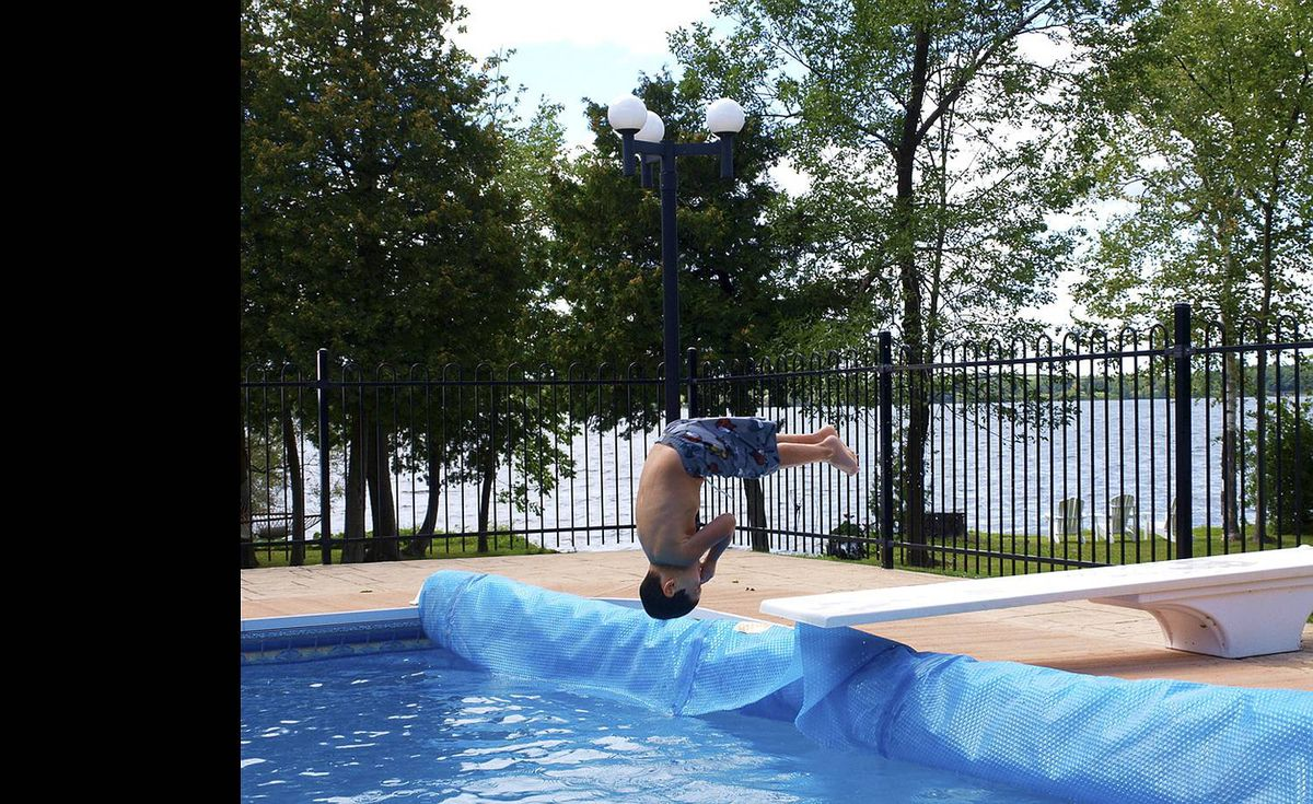 Dave Bross uploaded this image to our Flickr pool of his four-year-old nephew Nathan Goldwasser flipping into the pool.