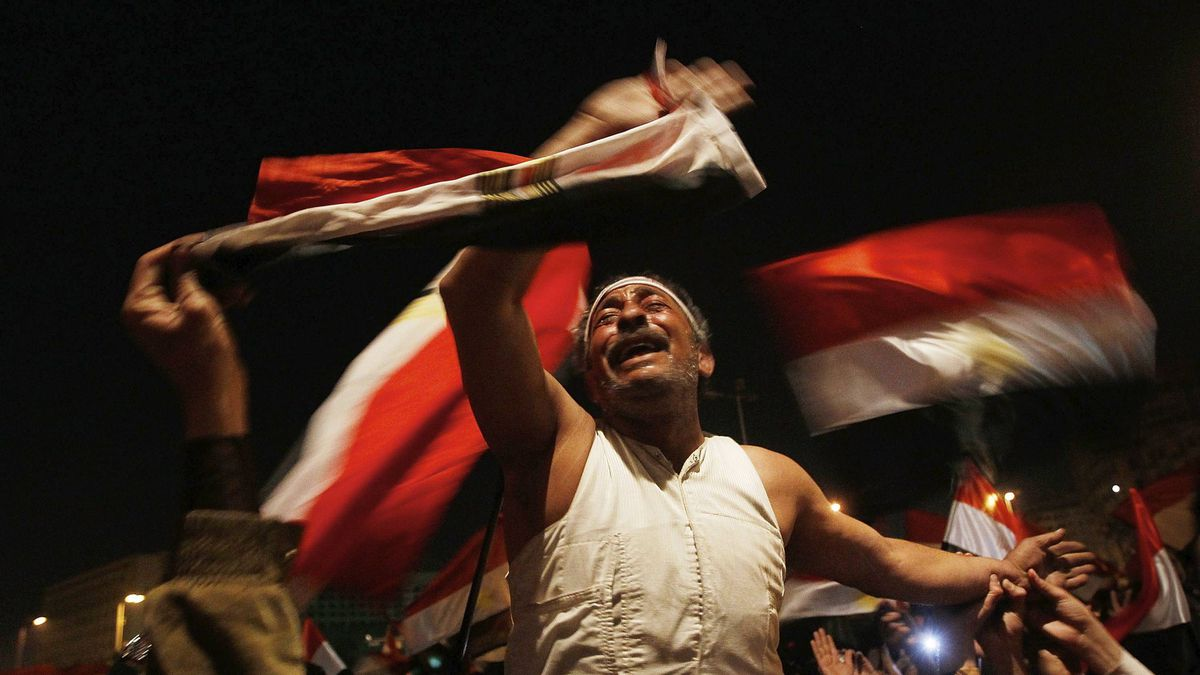 An anti-government protester reacts before Egyptian President Hosni Mubarak was to make a statement February 10, 2011 in Cairo, Egypt.