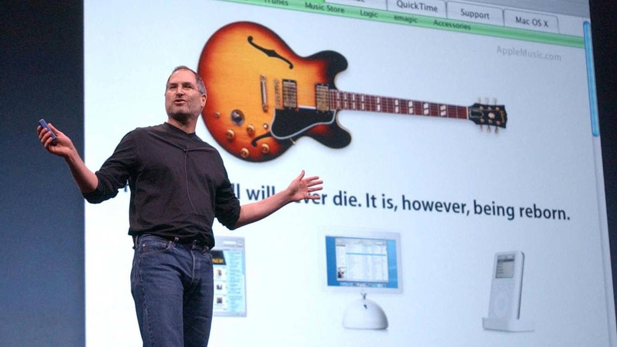 Steve Jobs gestures during Apple's launch of iTunes and a new iPod in San Francisco in 2003.
