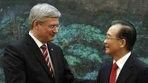 Canada's Prime Minister Stephen Harper (L) shakes hands with China's Premier Wen Jiabao following a signing ceremony at the Great Hall of the People in Beijing February 8, 2012.